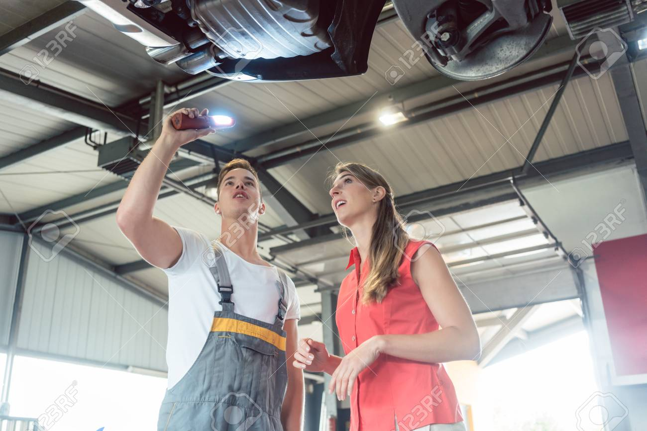 Reliable Auto Mechanics >> Low Angle View Of A Reliable Auto Mechanic Holding A Flashlight