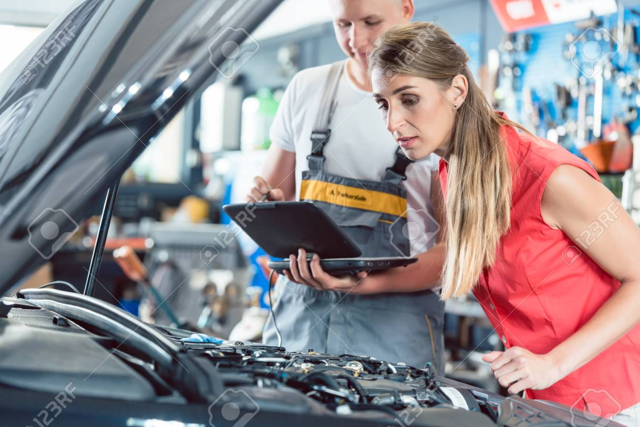 Reliable Auto Mechanics >> Reliable Auto Mechanic Showing To A Female Customer The Engine