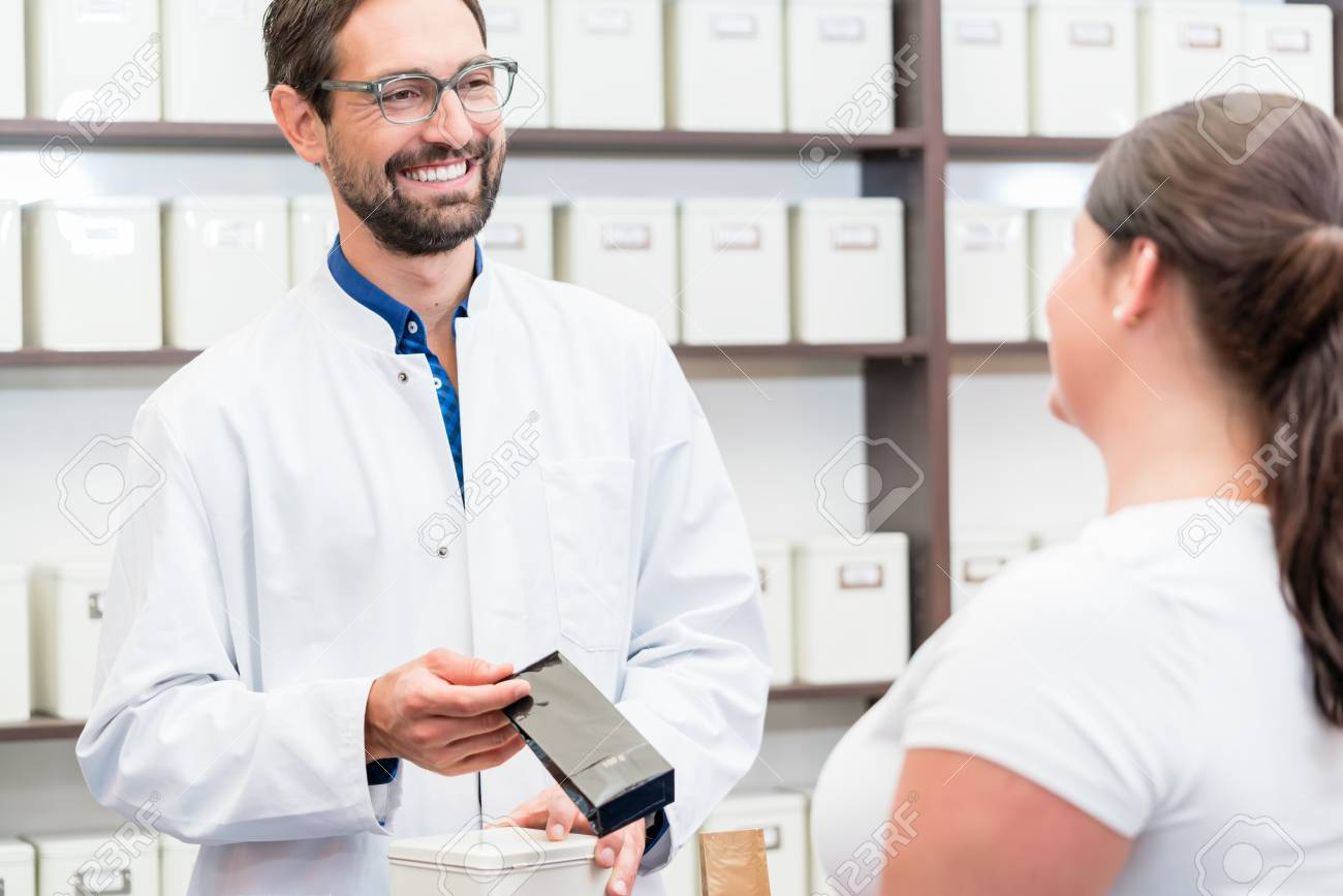Woman shopping alternative drugs at herbalist shop - 96348393