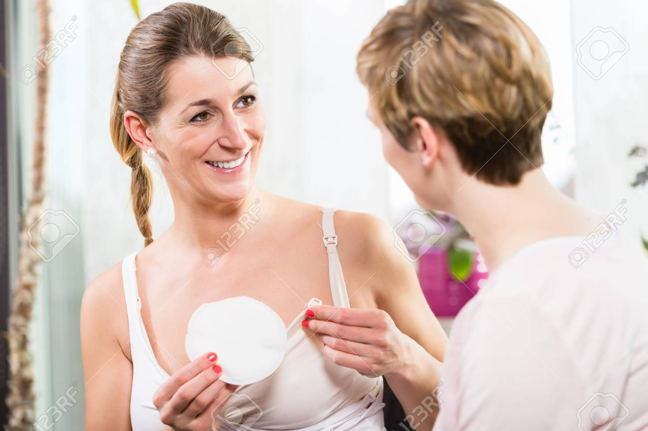 1f3807726f338 Woman using comfortable plastic breast shells inside bra for collecting  excess breast milk Stock Photo -