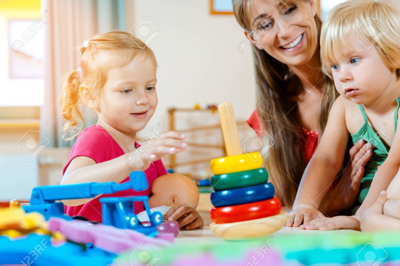Children in nursery school learning and playing games - 130058615