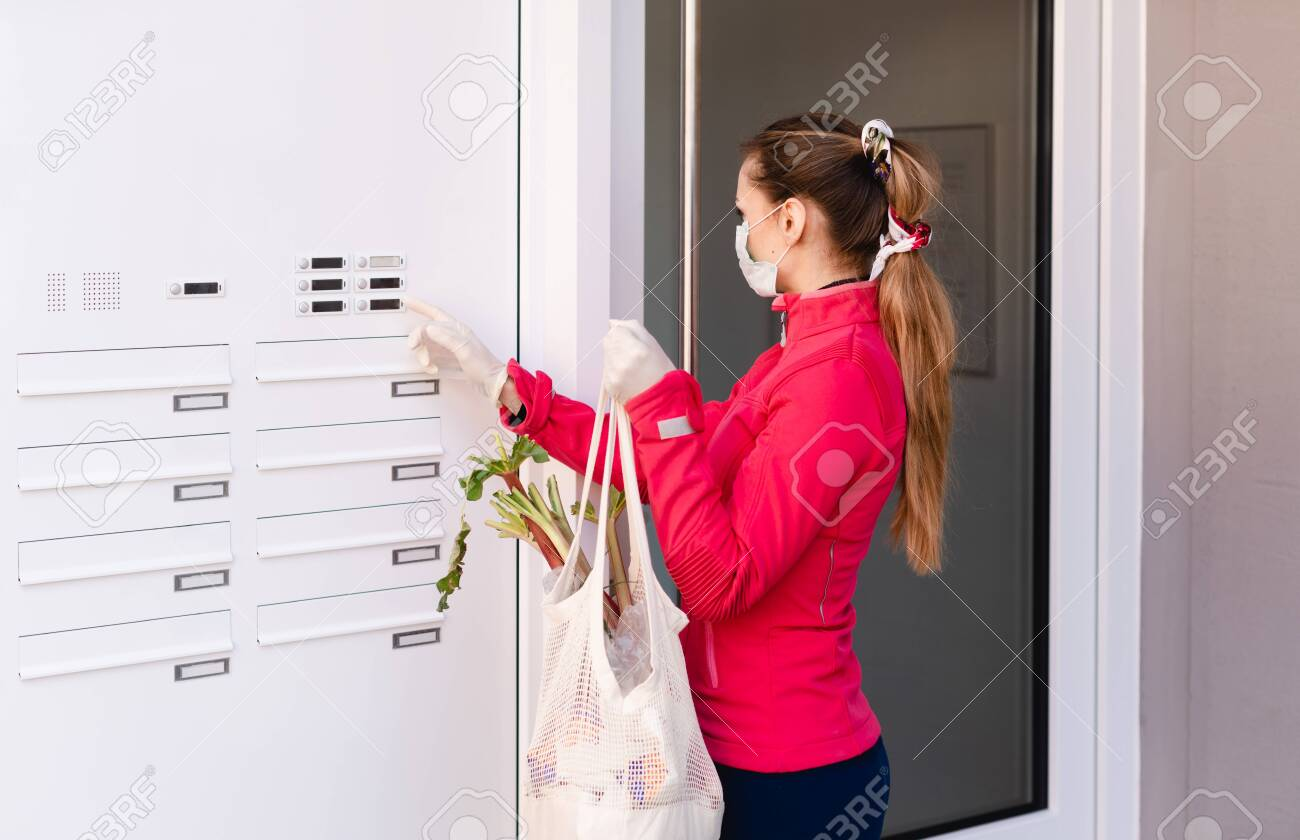 Young woman helping neighbors by shopping groceries for people in covid-19 quarantine - 144608100
