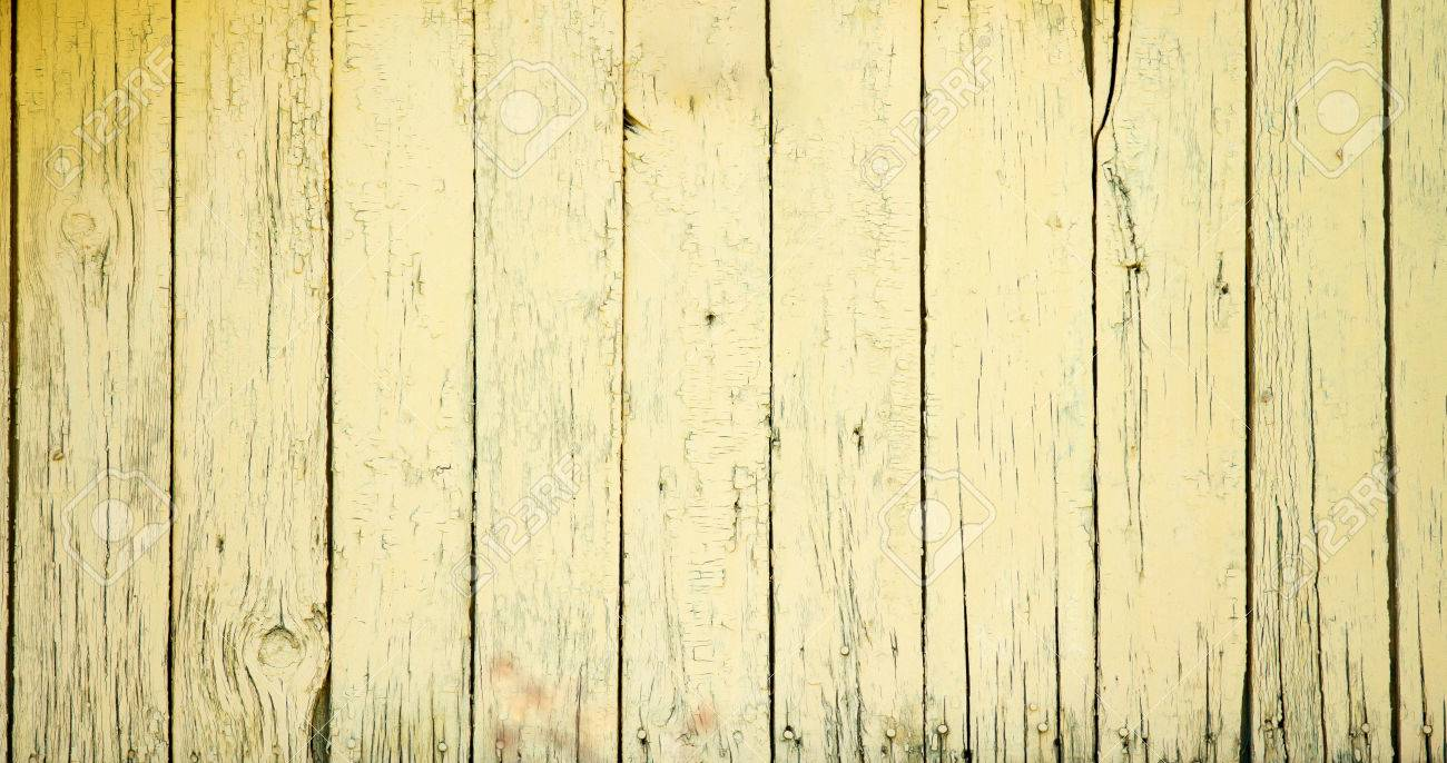 Old wooden fence with yellow paint stock photo picture and stock photo old wooden fence with yellow paint baanklon Images