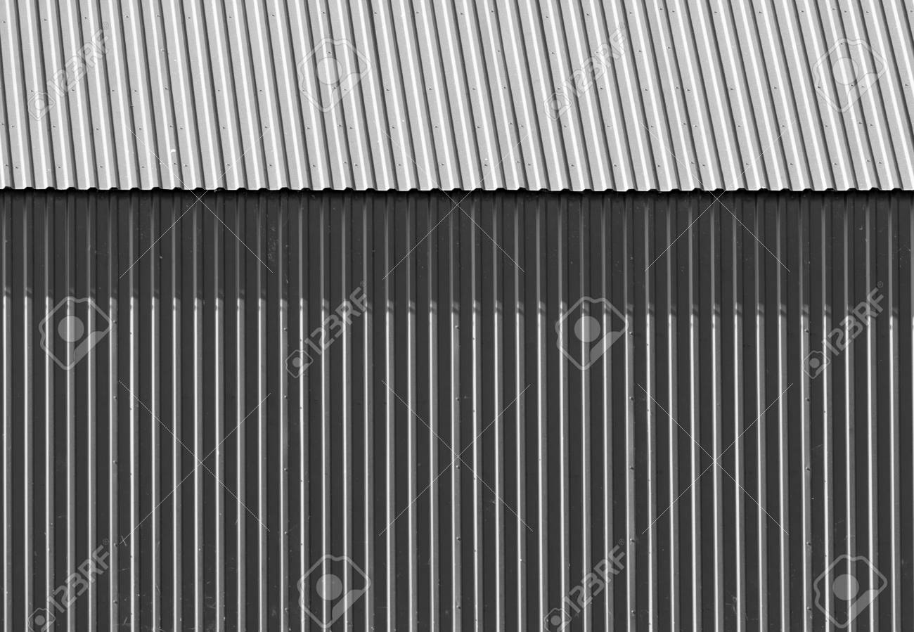 corrugated metal fence painted