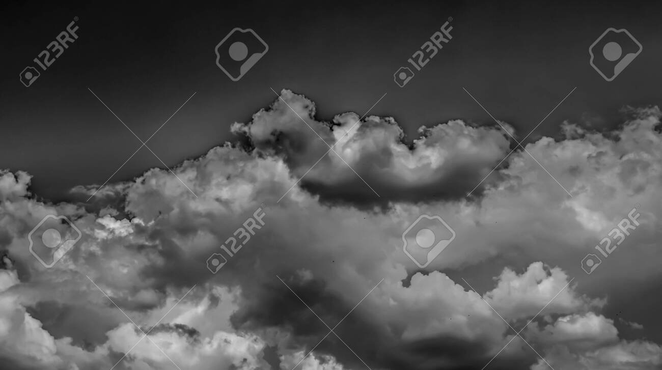 White clouds on a dark sky, monochrome. - 124300689
