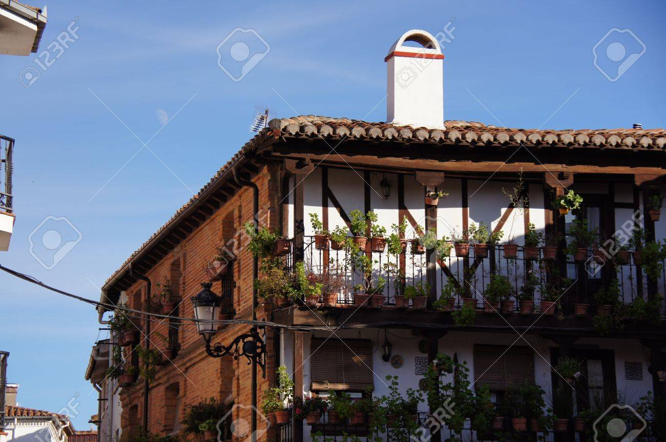 typical house of brick with visible structure of wood roof of