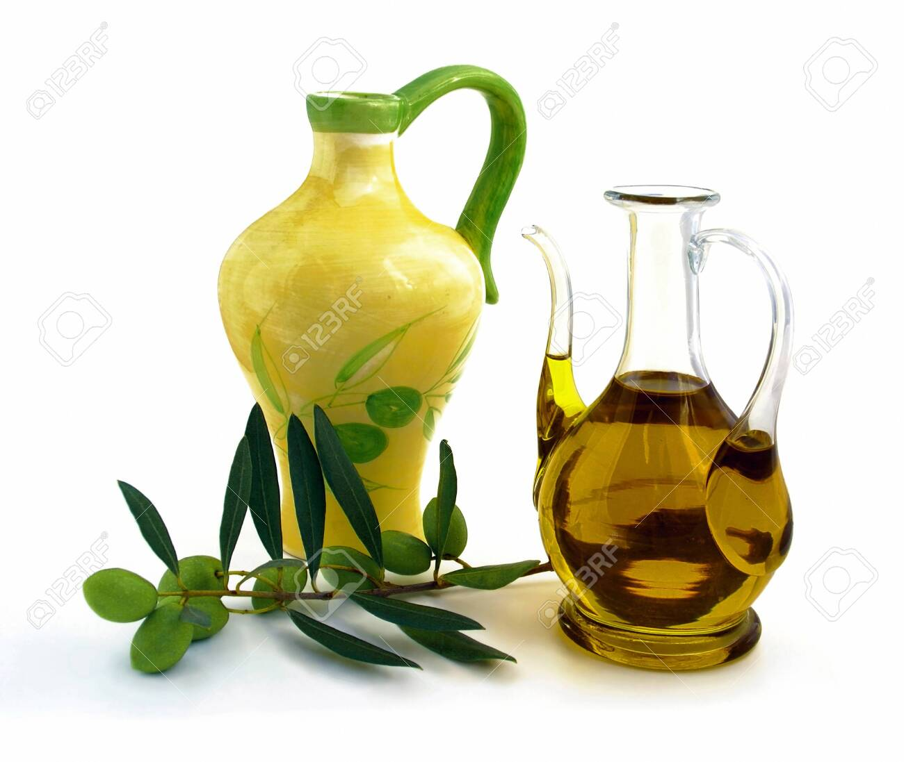 Carafe and small jug containing olive oil. White fand. - 128415887