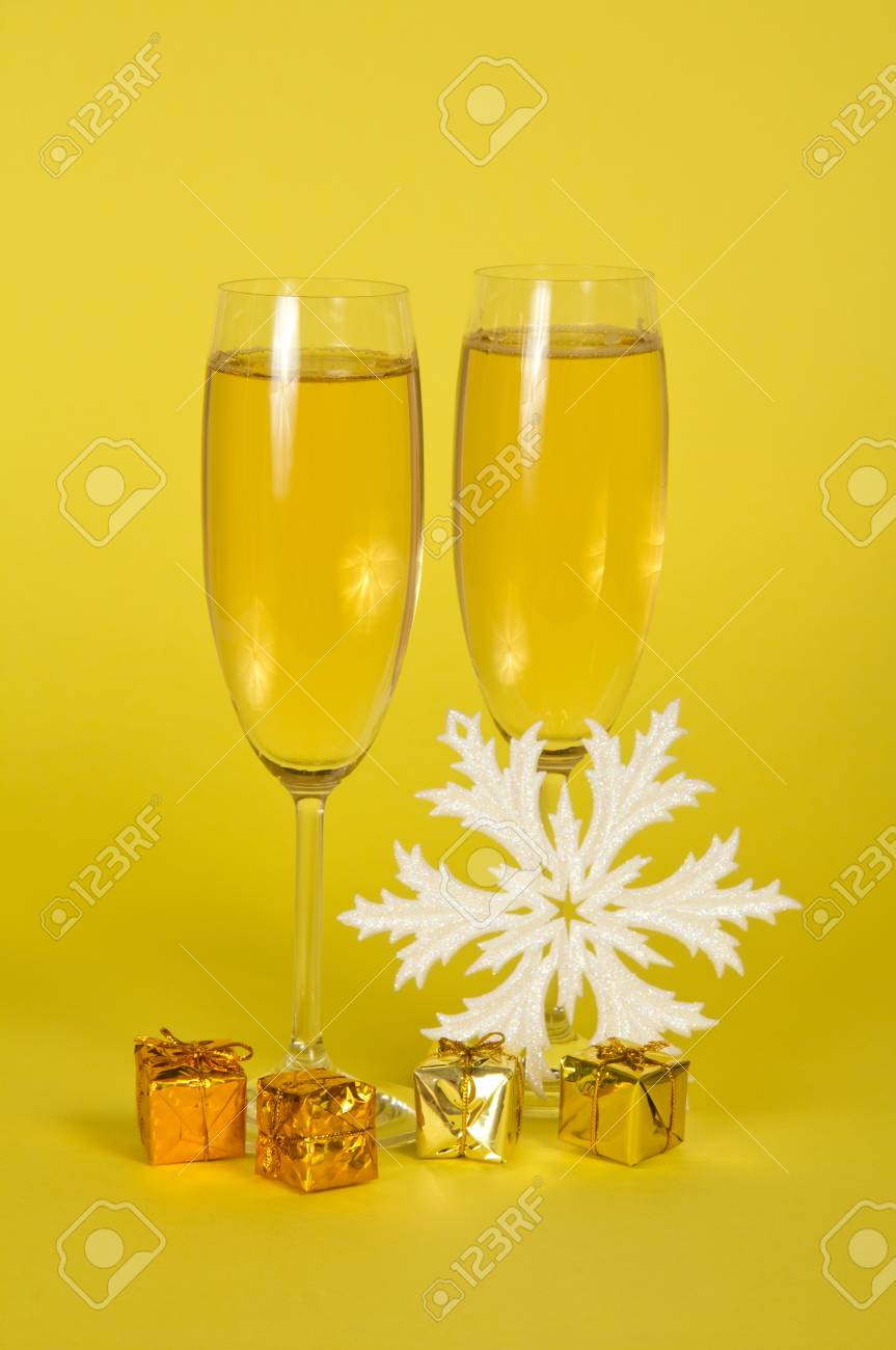 Christmas Champagne In Wine Glasses Small Gift Boxes And A Snowflake