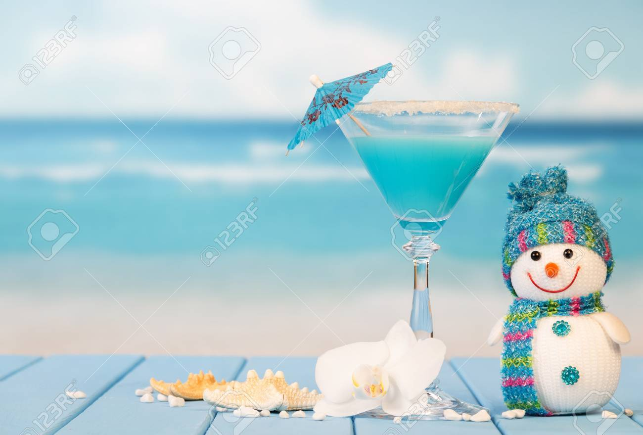 Cocktail, snowman, starfish and orchid flower on a background of the sea. - 65488006