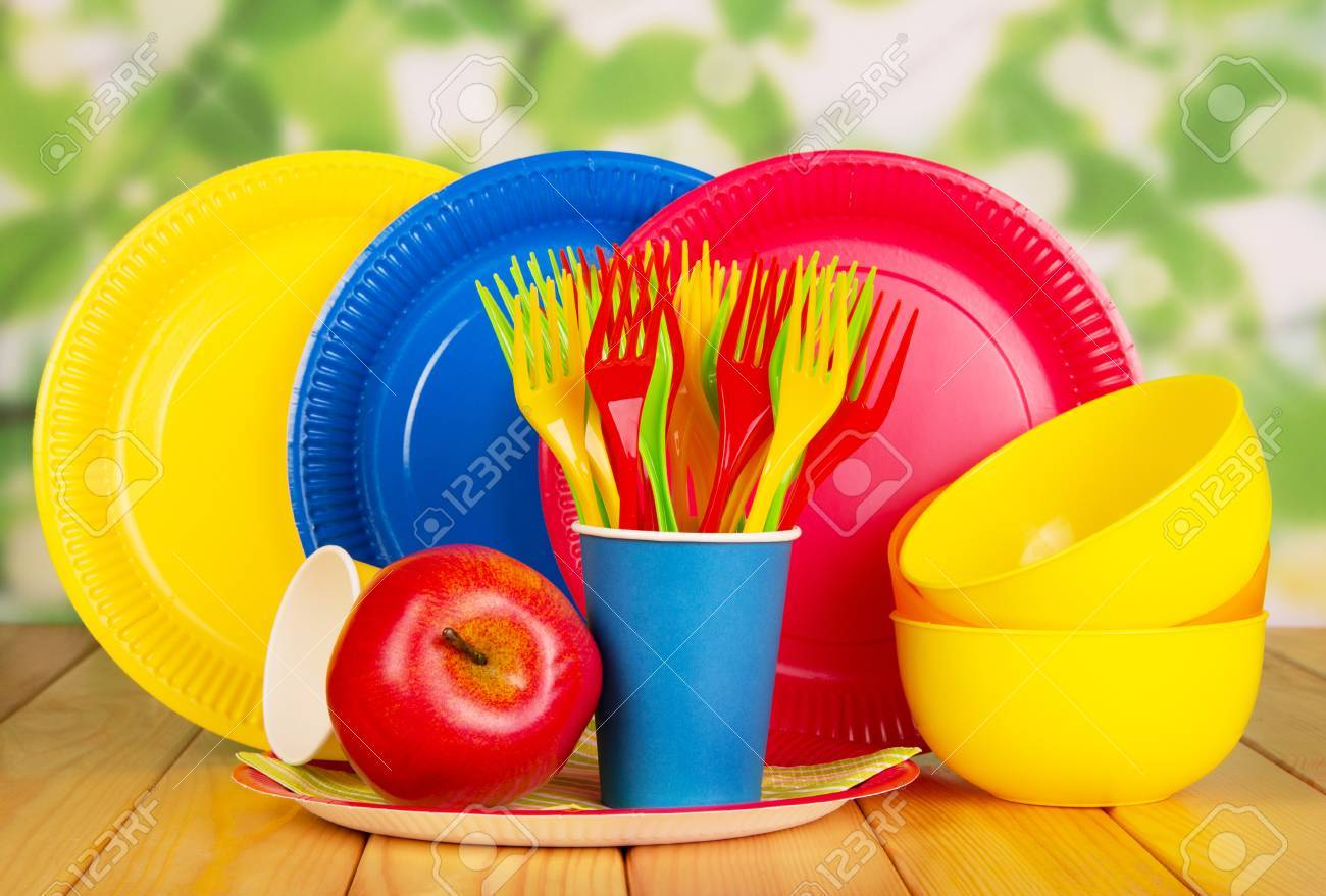 Bright disposable paper plates cups and plastic bowls forks apple on an abstract & Bright Disposable Paper Plates Cups And Plastic Bowls Forks ...