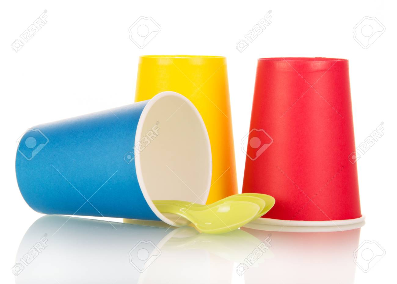 Multi-colored disposable plastic cups and spoons isolated on