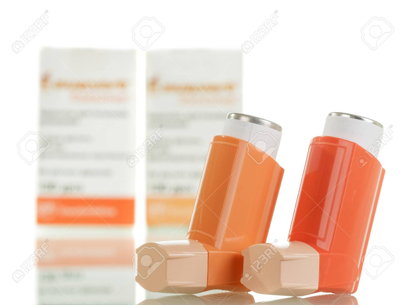 Two of the asthma inhaler and packaging of medicines isolated on white background. - 88002224
