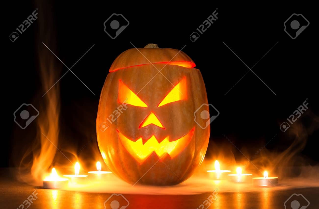 Scary Halloween Pumpkin Jack O Lanterns Isolated On Black Background Stock Photo Picture And Royalty Free Image Image 90217170