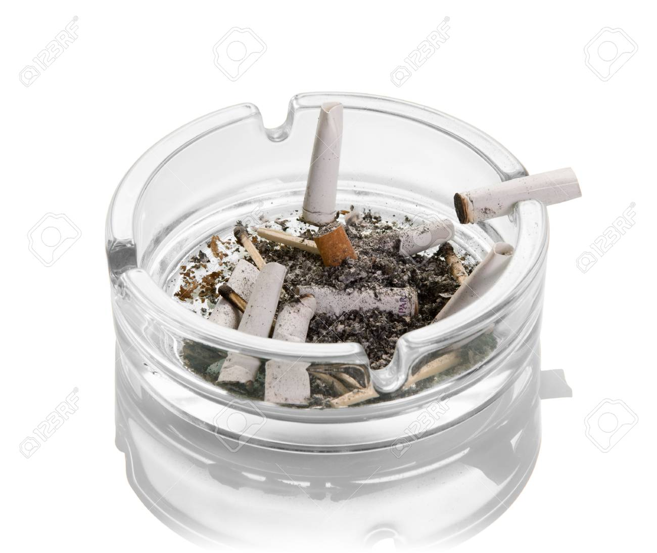 Cigarette butts, ashes, burnt matches in a glass ashtray isolated on white background. Close-up - 90684623