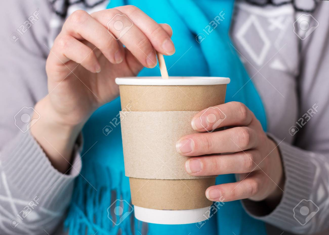 Special Cup for hot coffee takeaway, in hands of woman - 103925239