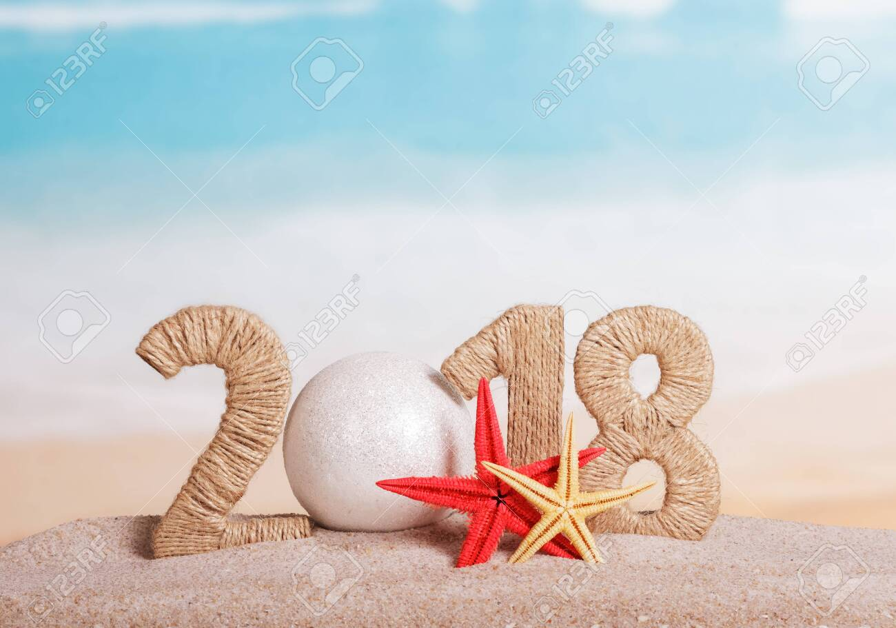 New Year inscription 2018, instead of the number - white ball, starfish in the sand on the beach. - 141934003