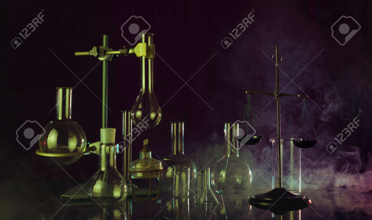 Fantastic chemical laboratory with smoke effect on dark background - 166758262