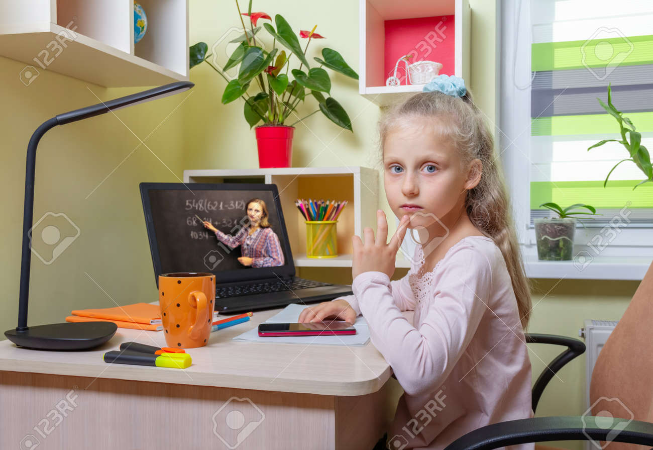 The girl pondered a difficult example. Online learning using a laptop from home - 170118045