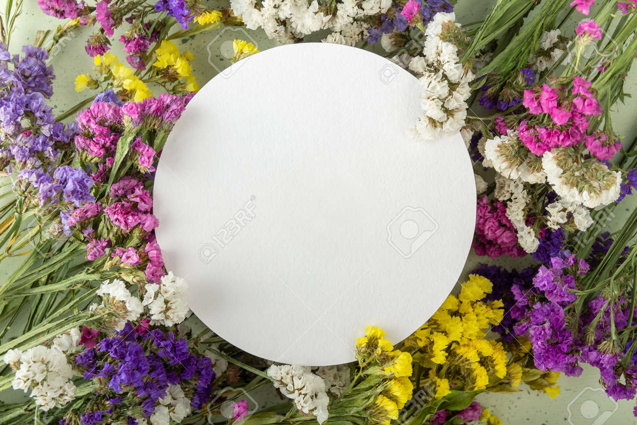 Bright card with an empty place for an inscription and multi-colored dried flowers - 170117793