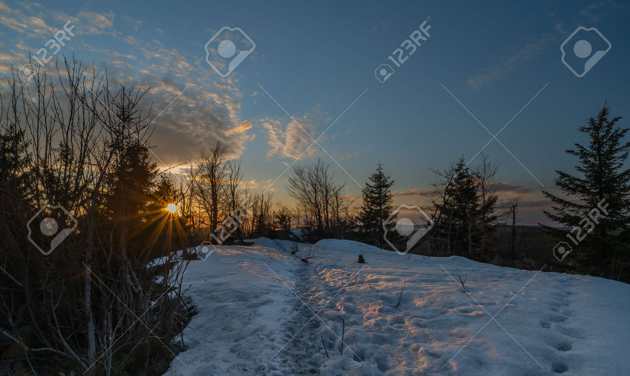 Sunset view from Bukovec hill with blue sky and orange color sun - 169616805