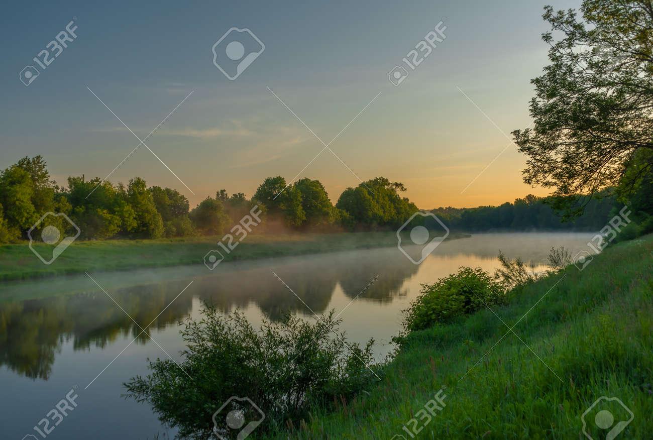 Vltava river near Budweis city in south Bohemia in sunrise fresh morning - 169616808