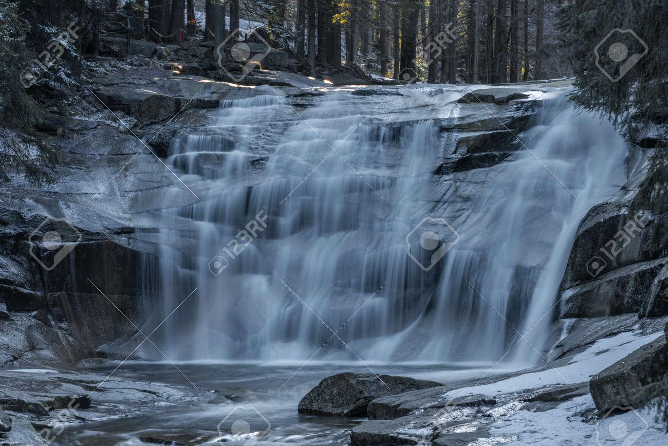 Cold spring morning with Mumlavske waterfalls near Harrachov town in Krkonose national park - 169798898