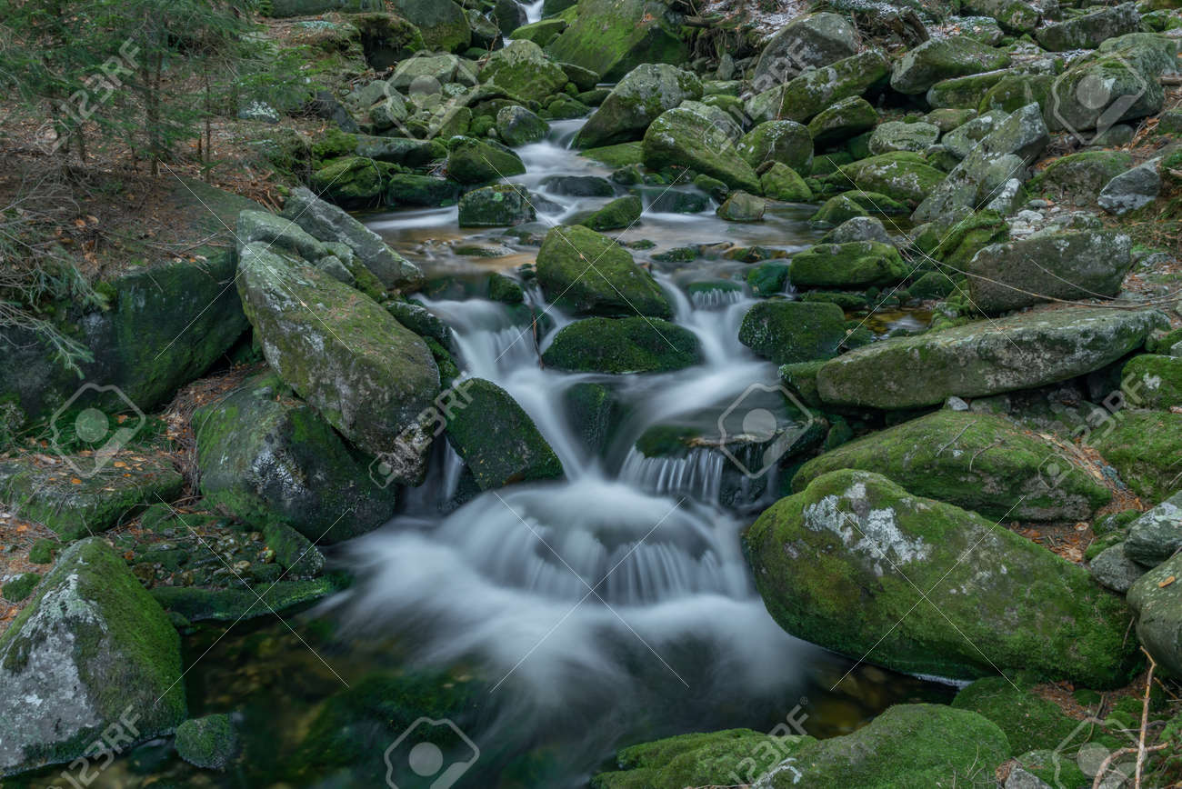 Small creek in Krkonose national park in cold spring with snow - 169798899