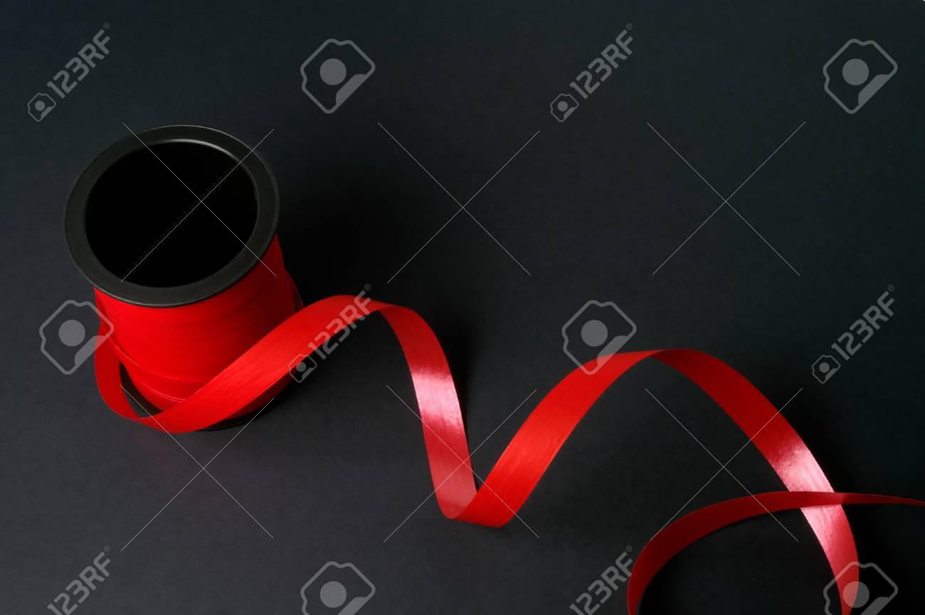 Red tape on black background Stock Photo - 963563