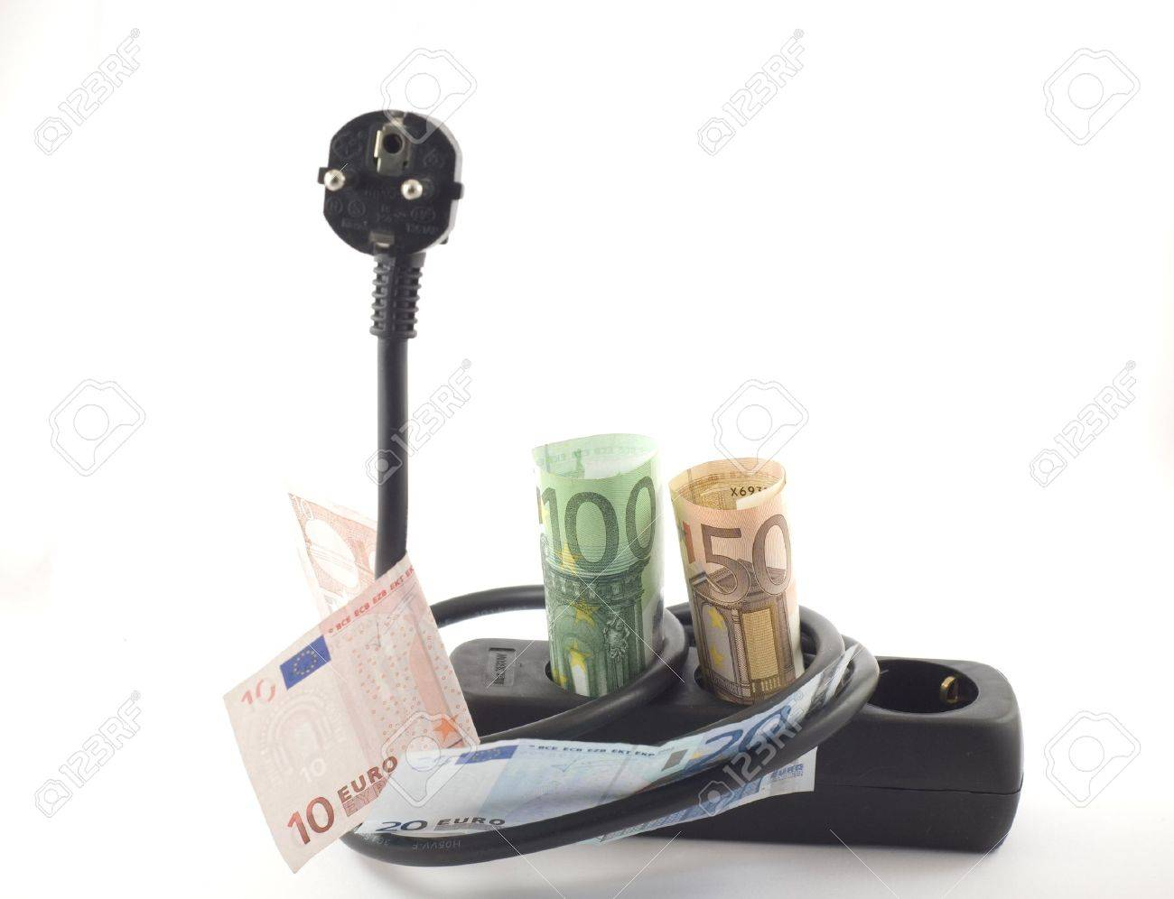 Electricity cable, plug and socket covered with banknotes. Stock Photo - 16852795