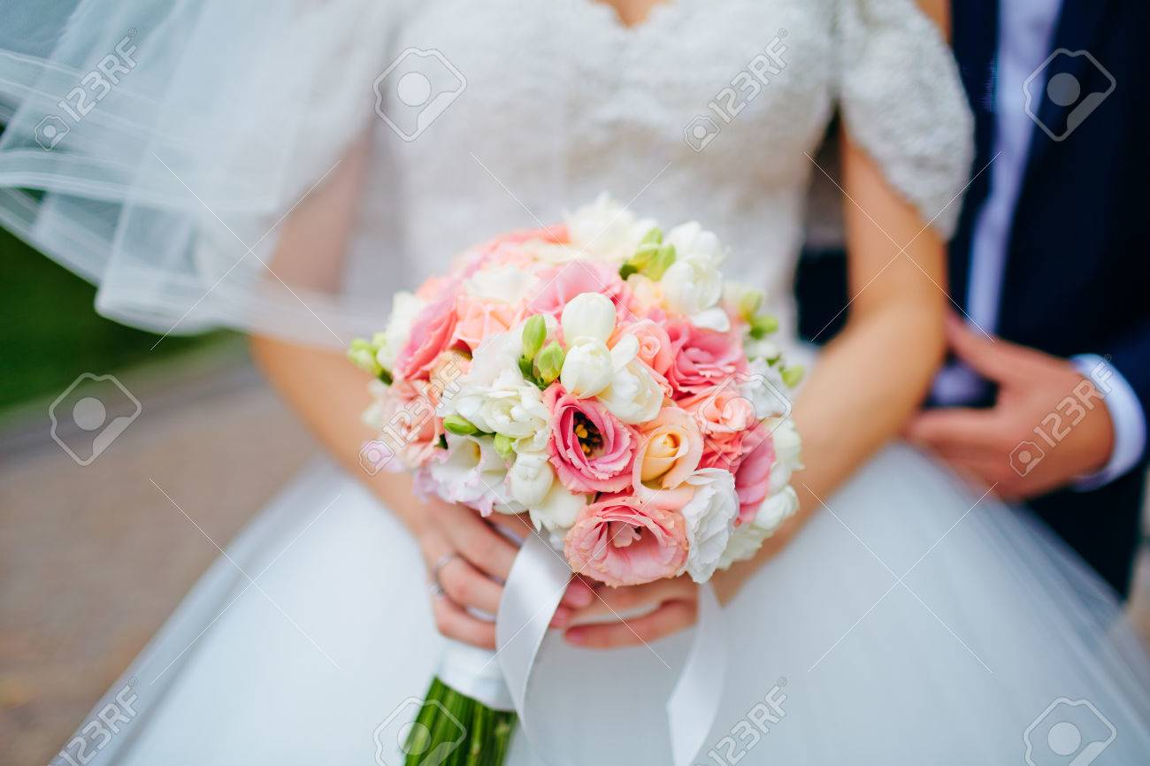 Bride hold groom by the hand and wedding bouquet focus on wedding bride hold groom by the hand and wedding bouquet focus on wedding flower bouquet izmirmasajfo