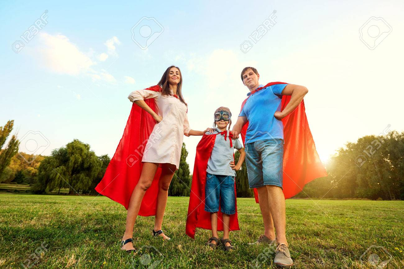 Superheroes family. Mother, father and son in the costumes of superheroes in nature. Mother's Day, Father's. - 65699617