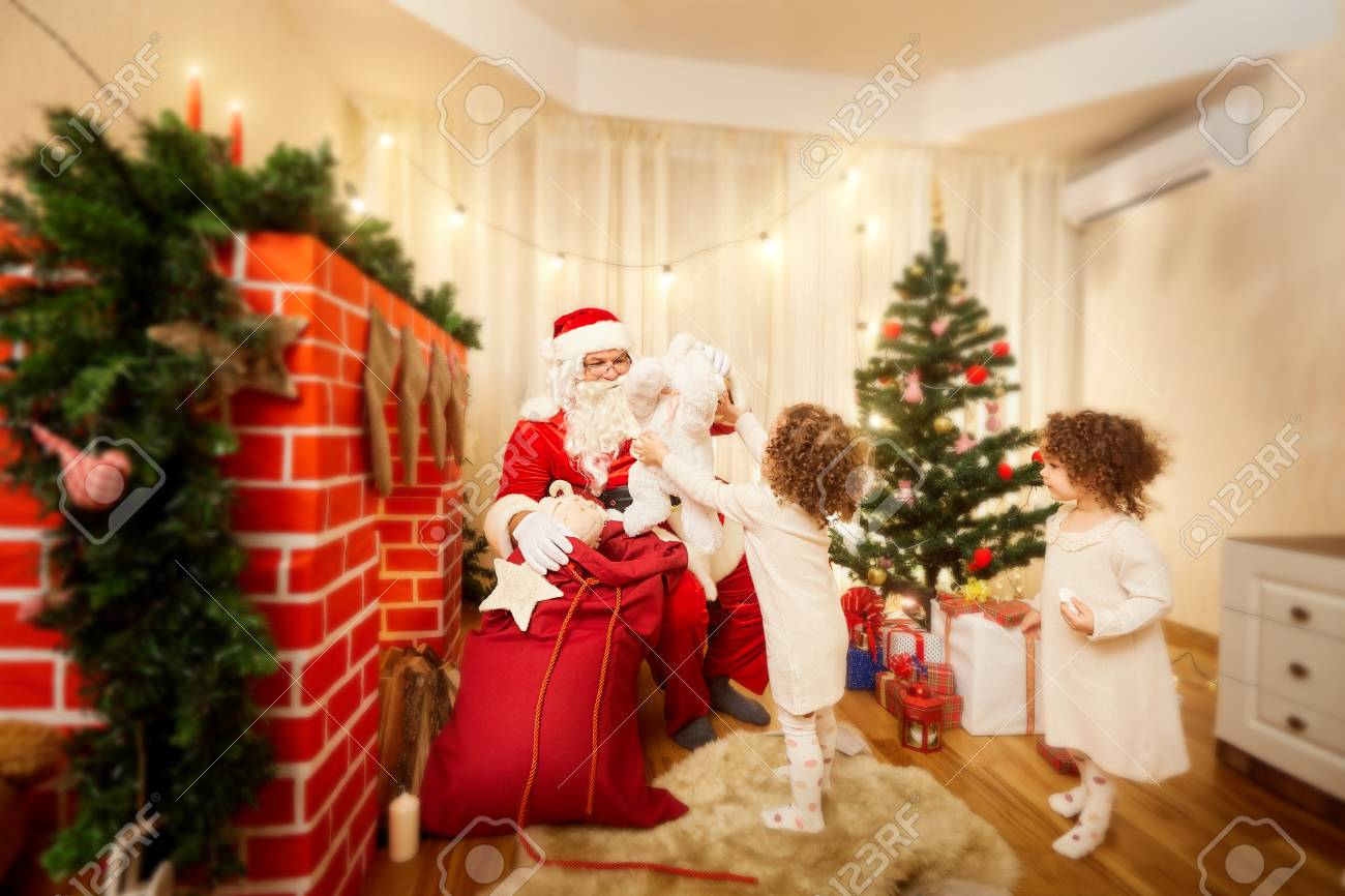 In Christmas Santa Claus Distributes Gifts To Childrens Out Of ...