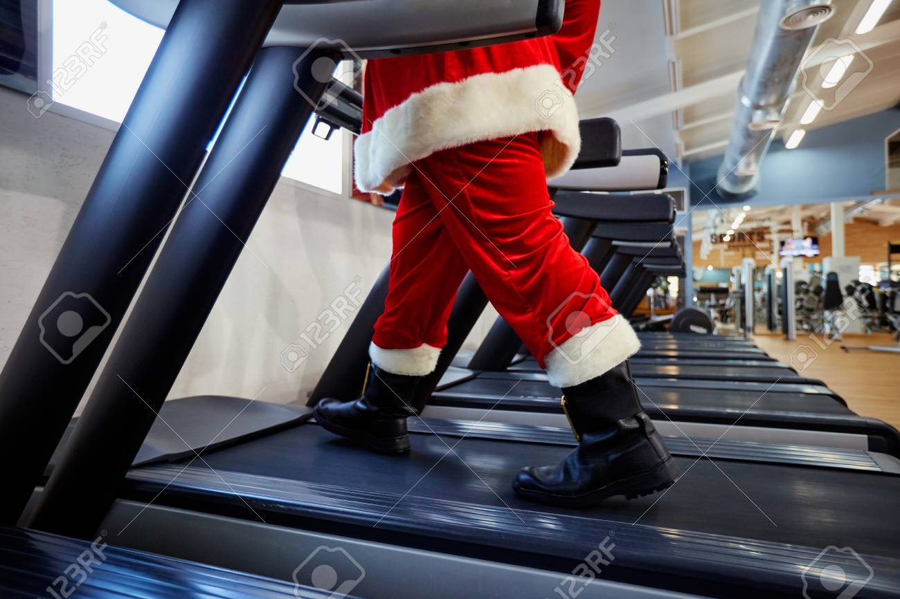 Santa Claus in the gym doing exercises. - 88259971