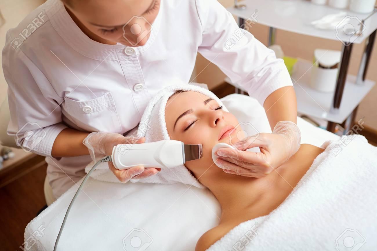 Woman on facial skincare procedure.Hardware cosmetology. - 93075272