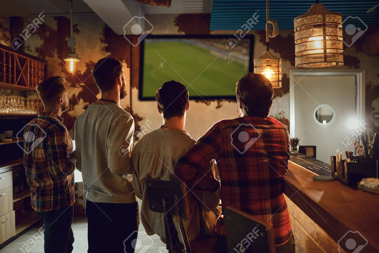 A Group Of People Watching Tv Football In A Sports Bar Fans Stock Photo Picture And Royalty Free Image Image 136124321