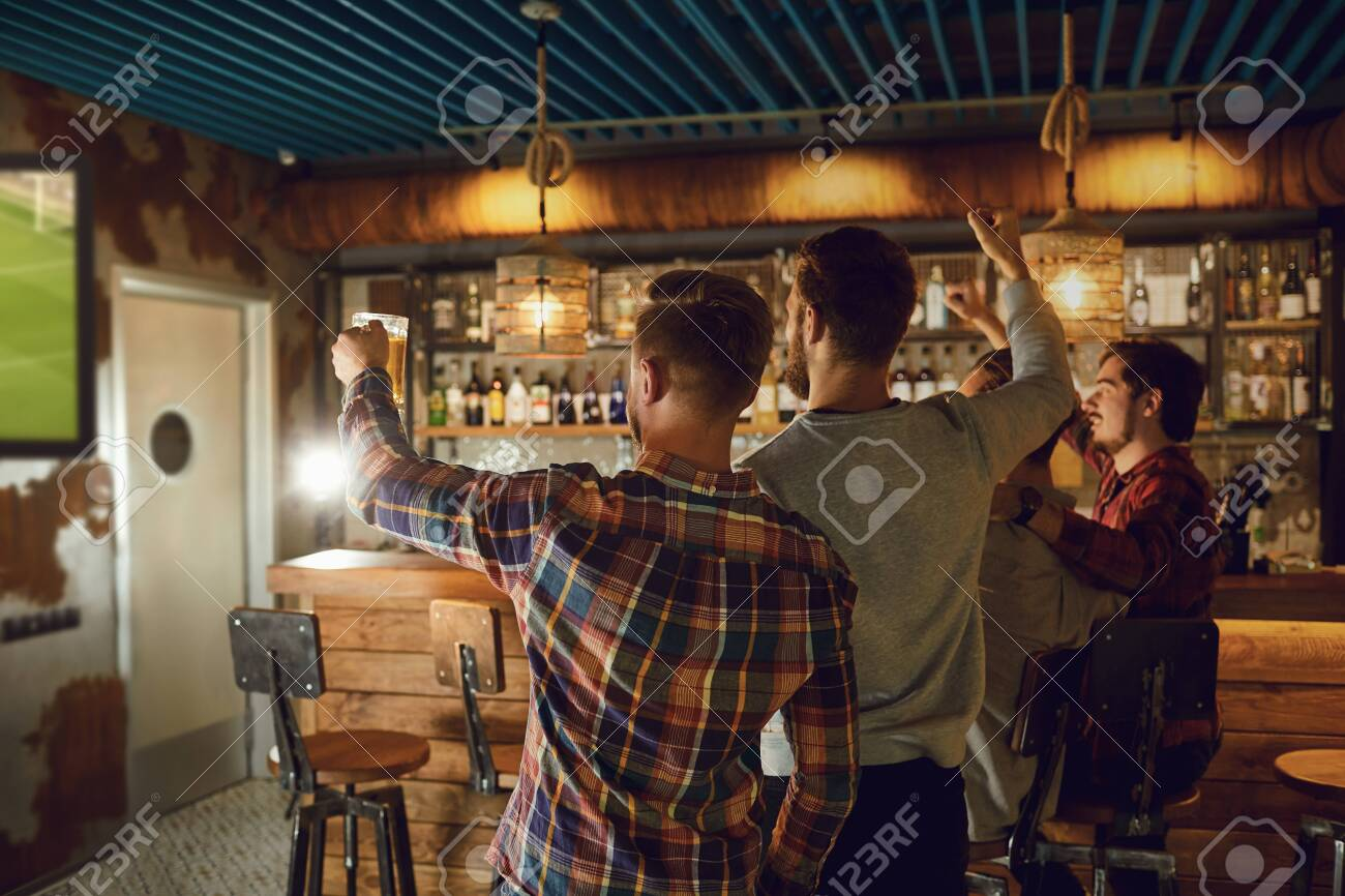 A Group Of Friends Watching Tv Football In A Sports Bar Back Stock Photo Picture And Royalty Free Image Image 137127435