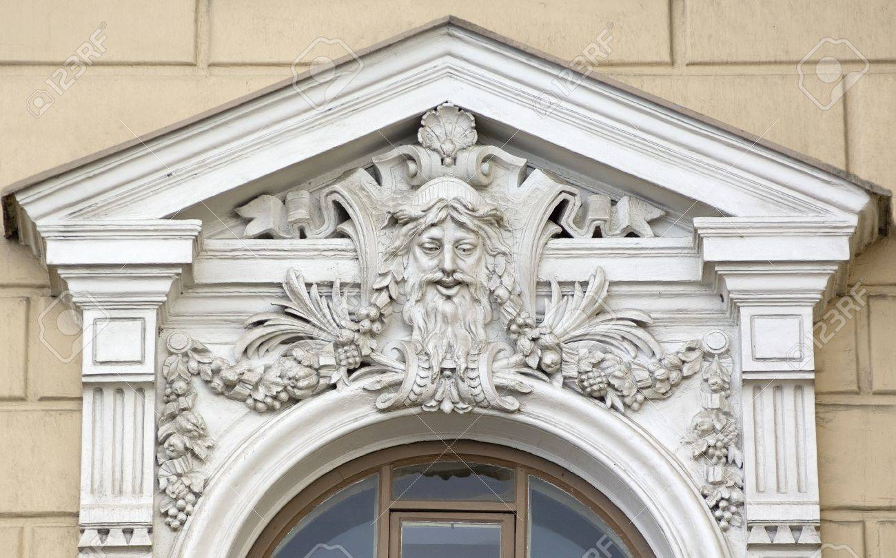 Building Relief Detail Of Architectural Frieze With Human Head Stock Photo