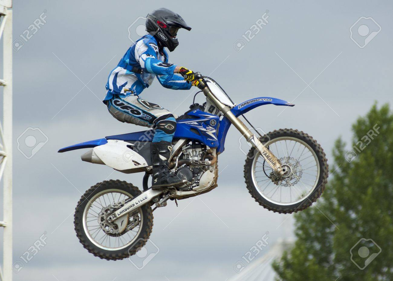 MOSCOW - JUNE 24  P Silaev on a clubs tournament of motocross competition of Red Racing Group club on June 24, 2012 in Moscow, Krilatskoe, Russia Stock Photo - 16233327