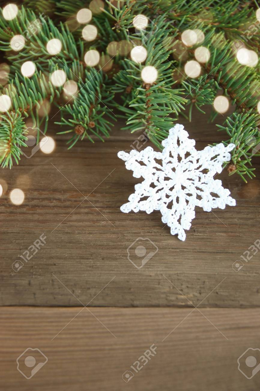 White Cotton Crocheted Snowflakes Near Green Christmas Fur Tree Stock Photo Picture And Royalty Free Image Image 107313184
