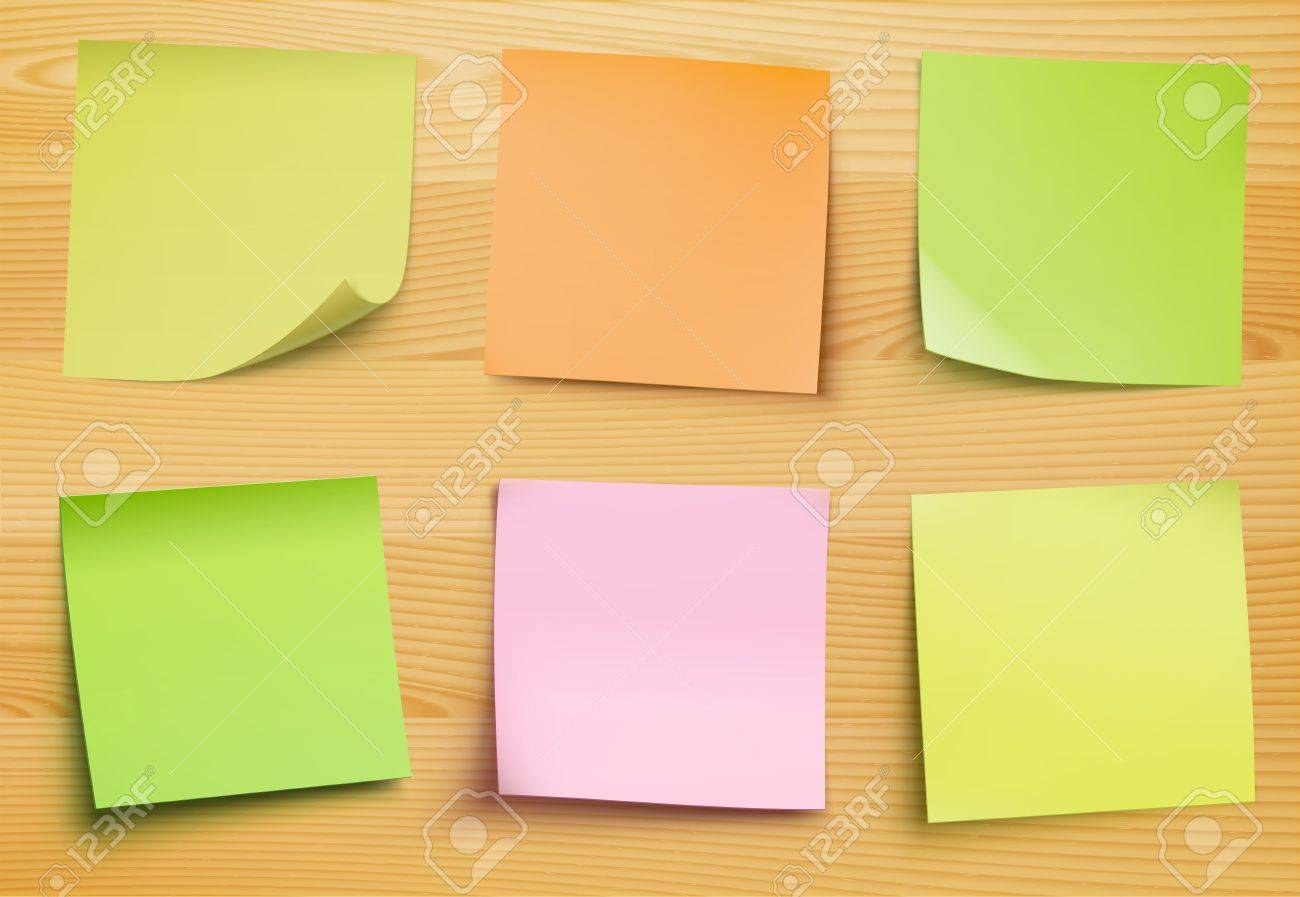 collection of post it notes in several colors on the wooden plate for your own text or image - 16616546