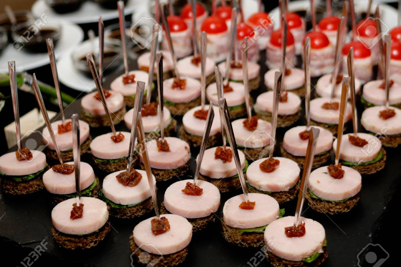 Luxury Banquet Table Setting.canape With Ham, Buffet Table Stock ...