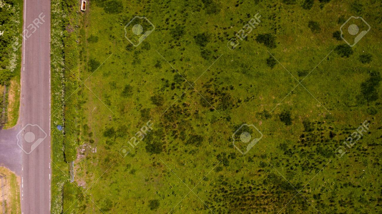 grass field aerial. An Aerial Photograph Of A Rich Green Field. The Grass Textures And Patterns Are Visible Field