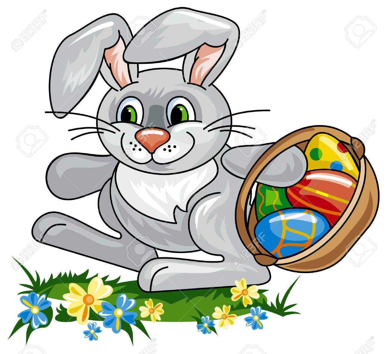 easter bunny with a basket full of easter eggs royalty free