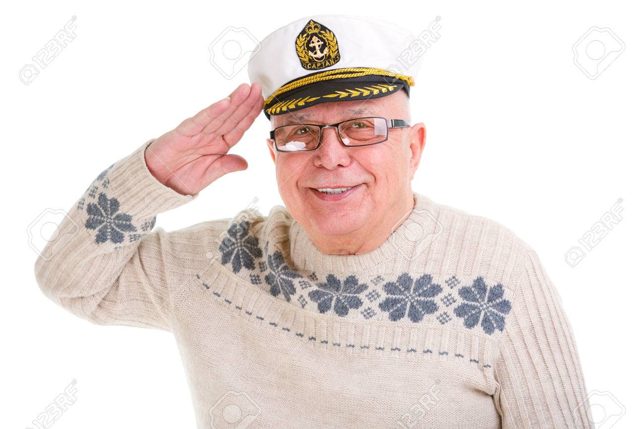 bb705d02dedc8 Closeup portrait of happy old senior man saluting with a boat captain cap