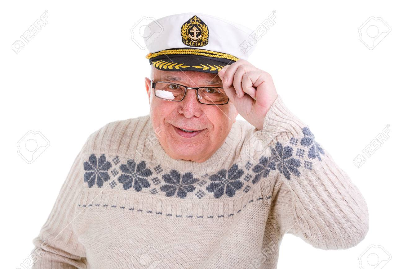 8703316d1f4a6 Closeup portrait of old senior man with a boat captain cap. Isolated Stock  Photo -