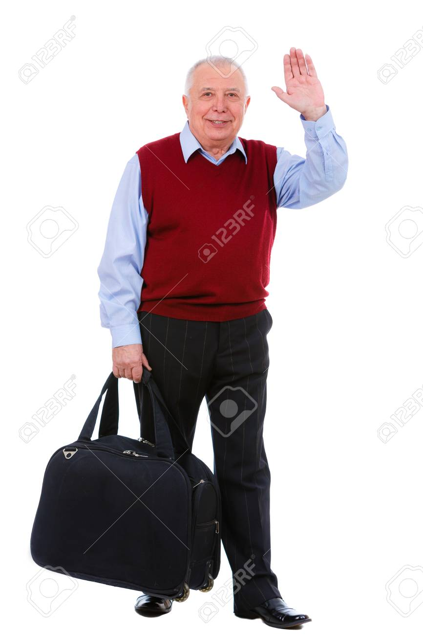 3cf07fa0a9543 Happy Old senior man holding a suitcase and waving his hand isolated on  white background.