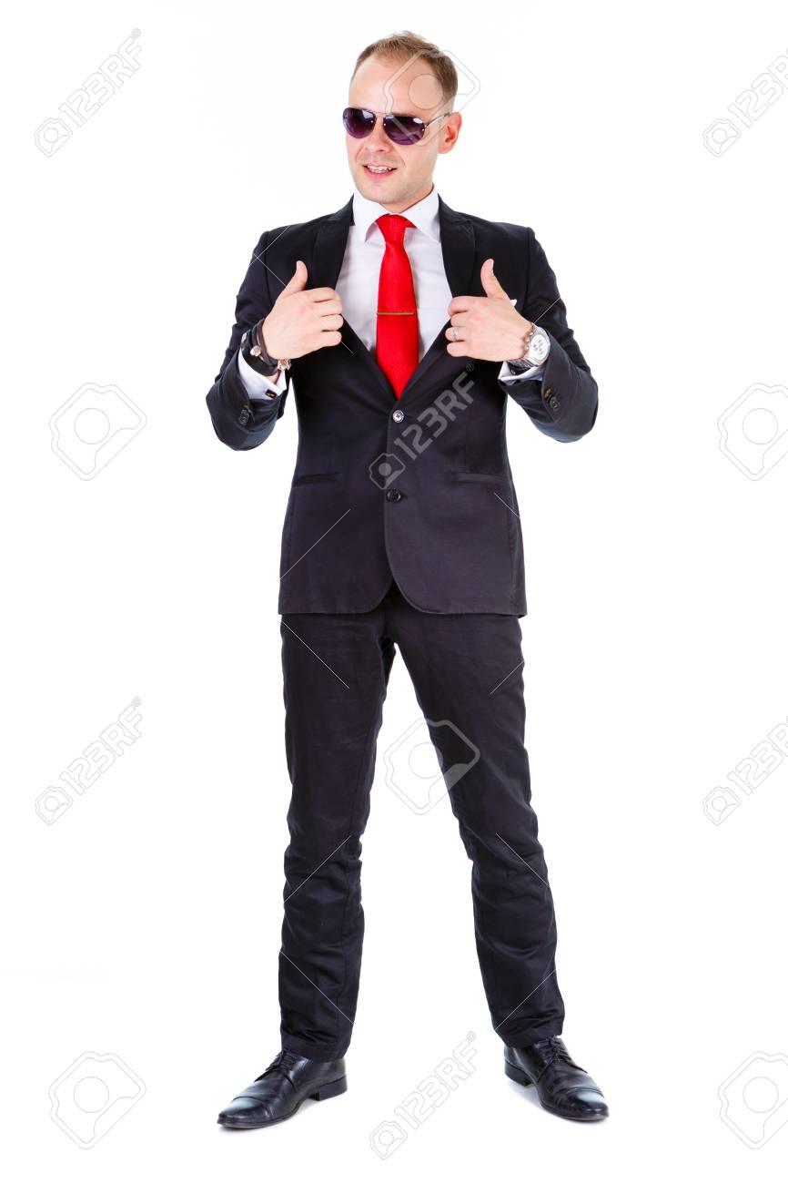 b5739da079 Full length of Elegant business man in black suit, red tie and black  glasses,