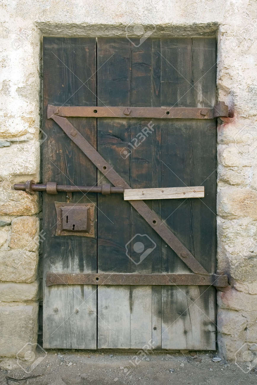 Ancient Wooden Door Closed With A Slide Bolt Latch Stock Photo