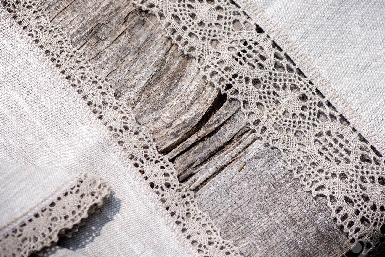 Macro Shot Of Linen Tablecloths And Napkins With Grey Crochet