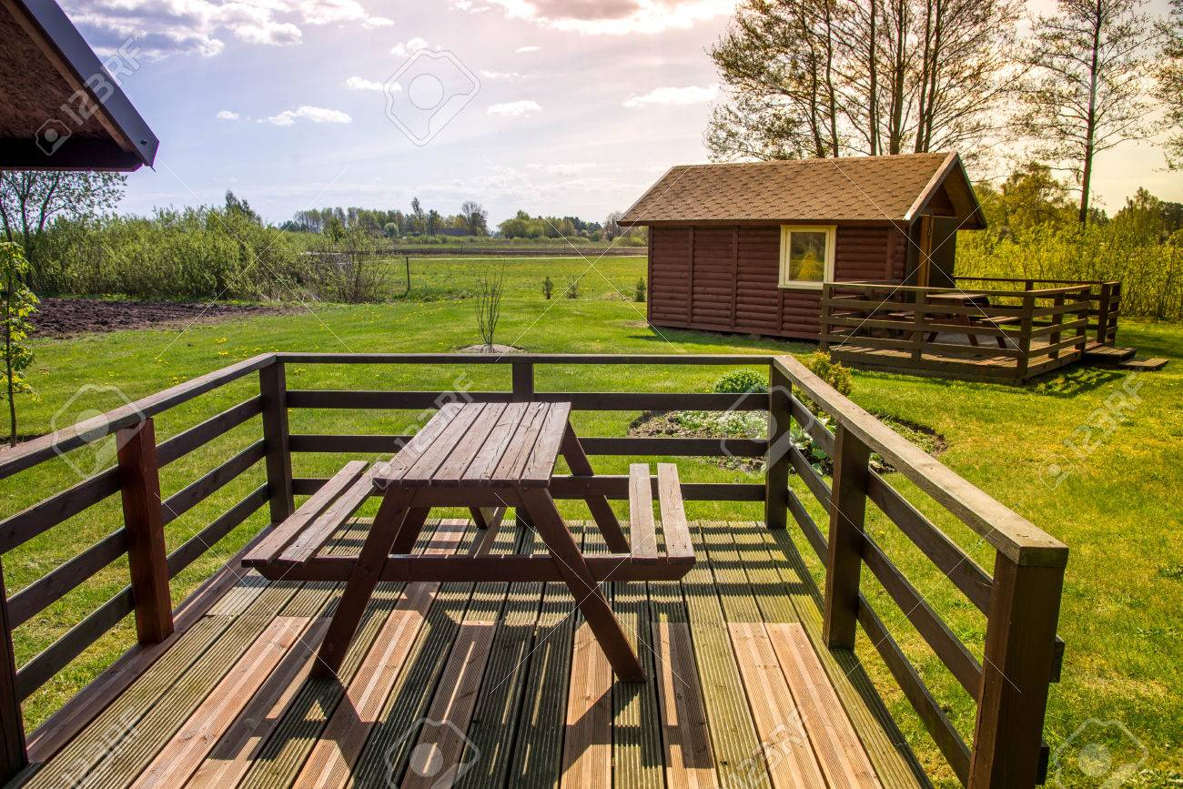 Picnic Table On A Wooden Terrace In Garden In Early Morning Stock Photo Picture And Royalty Free Image Image 72292268